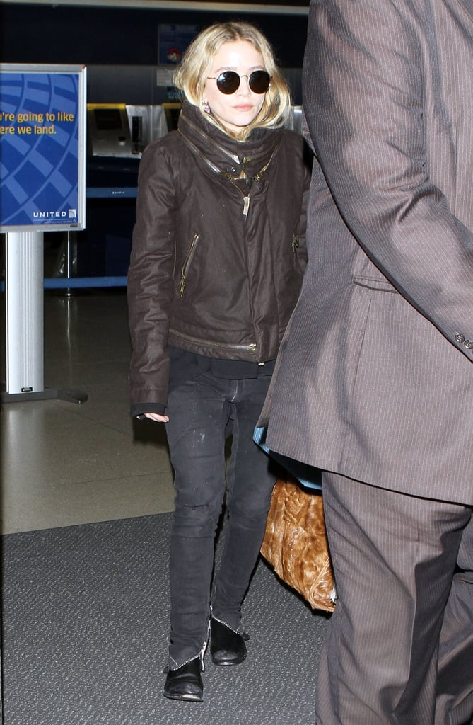 Mary-Kate Olsen followed right behind her sister Ashley when they touched down at LAX yesterday. The designers, who are featured in April's Vogue, are on the West Coast following a very social stint in NYC. They were together to toast their pal Vanessa Traina's Maje collection and for a night at the opera, after which Mary-Kate shared a cozy celebration with YSL designer Stefano Pilati. Mary-Kate and Ashley also got the good news that they're up for a CFDA award for their work on The Row, which continues to expand with a new foray into menswear.