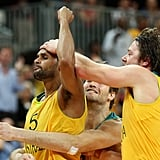 Australian basketball players celebrated together.
