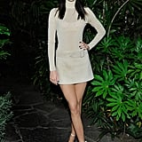 Kendall's glittering poloneck was slightly sheer and looked '60s-inspired when paired with a belted mini and neutral ankle-strap sandals.