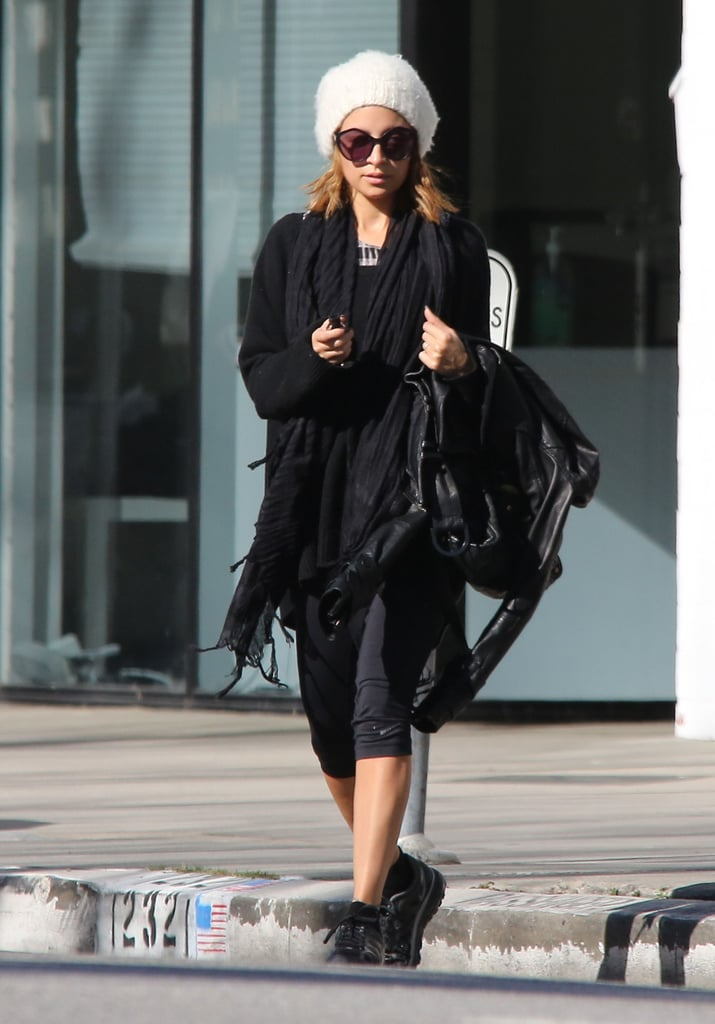 Nicole Richie kept her workout gear fashionable in a fuzzy white beanie.    Shop similar beanies below: