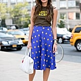 A ladylike printed midi got a street-cool makeover with a laid-back t-shirt and statement heels.