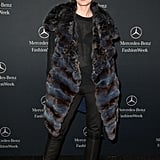Debra Messing arrived in a fur coat.