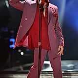 Working a suit on stage at the American Idol season five finale show in 2006.