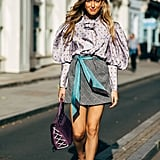 Dress up a miniskirt with embellished footwear and a frilly blouse.