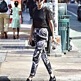 Gigi stepped up her casual style with printed trousers and polished booties.