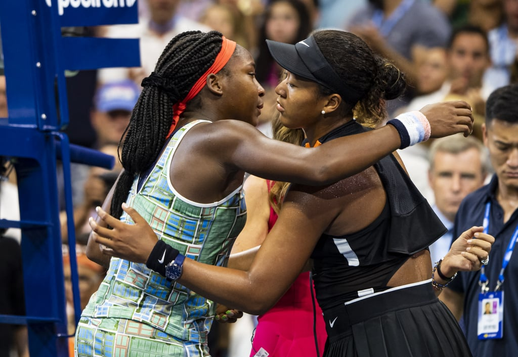 "Naomi Osaka and Coco Gauff exemplified sportsmanship after their incredible US Open match on Aug. 31. After Japan's Naomi won 6-3, 6-0, she hugged Coco across the net and invited the 15-year-old athlete to join her for an encore interview. Coco became emotional and expressed hesitation but Osaka encouraged her to seize the moment and address the crowd who came to see her.  ""I'm going to learn a lot from this match. She's been so sweet to me, so thank you for this. Thank you,"" Coco said in the interview. ""Thank you, Naomi. I don't want people to think that I'm trying to take this moment away from her, because she really deserves it."" After Coco spoke, Naomi directed her attention to Coco's parents in the stands. Naomi and Coco both live in Florida and grew up training in the same place. Through her own tears, she applauded Coco's parents for raising an ""amazing player."" Naomi later opened up about the match further in a press conference.  ""When I shook her hand, I saw that she was kind of tearing up a little. Then it reminded me how young she was,"" Naomi said. ""I was just thinking, like, it would be nice for her to address the people that came and watched her play. They were cheering for her."" This sense of sisterhood echoes back to Naomi's match against Serena Williams at the US Open last year. After Naomi defeated the veteran tennis player, Serena defended her opponent against an upset crowd. It appears Naomi is paying this kindness forward — an act we look forward to seeing from more and more athletes."