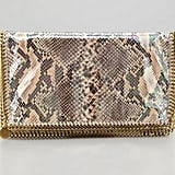 We dig the mix of chain and snake in Stella McCartney's Falabella snake-print foldover clutch ($1,075) — edgy-meets-sophisticated.