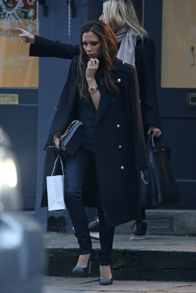 Victoria Beckham went shopping in the Notting Hill neighborhood of London today. She left Aimé boutique wearing dark skinny jeans and a military coat with a small bag in hand. Victoria took time to shop for herself during a break from prepping her own collections, which she'll show during NY Fashion Week on Feb. 10. It's just one of many projects for Victoria, who also announced her new Victoria Beckham website today. The site will launch next month and allow fans to purchase her designs directly as well as browse videos and other content.  Victoria is keeping busy in the UK after she and her family moved back to their home country from LA late last month. Her husband, David, stepped out in London on Wednesday to watch the Chelsea team's under-14 squad training session. He was in the stands cheering on son Brooklyn, who appears to be following in David's soccer footsteps.