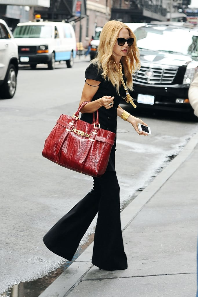Rachel Zoe added a pop of color to her all-black ensemble with a red bag as she walked around NYC today. She was headed into Lucky Magazine's Fabb event, where she dished out style and career advice. Rachel is on the East Coast for Fashion Week, during which she'll show the latest designs from her namesake collection. In addition to a fashionable few days coming up, Rachel has another reason to get excited. Bravo just announced that  The Rachel Zoe Project will return for its fifth season. Rachel is also working on a book that she hopes will be released sometime next year and, of course, she's juggling it all with being a mom to her 1-year-old son, Skyler.