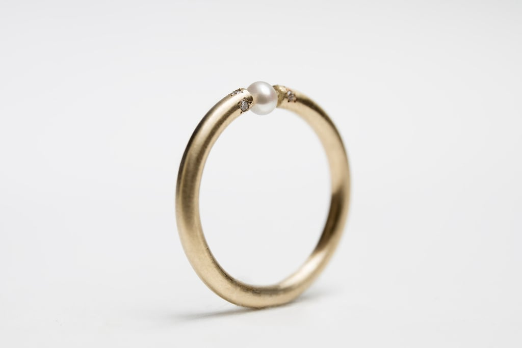 A pearl engagement ring ($420) with an industrial look for minimalist brides.