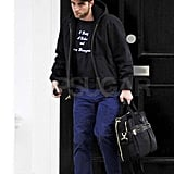 Robert toted a big bag in London.