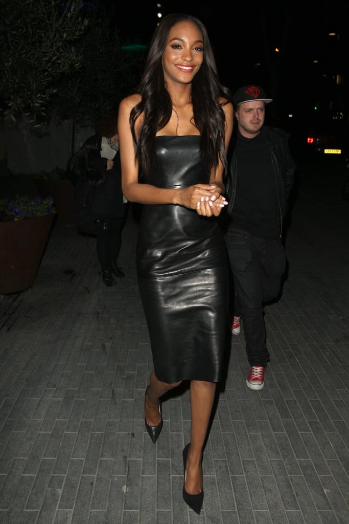 Jourdan Dunn kept it sexy and sophisticated in a leather strapless dress while out and about in London.