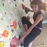 On a climb up the bouldering wall, actress Nina Dobrev found a friend in Buddha.