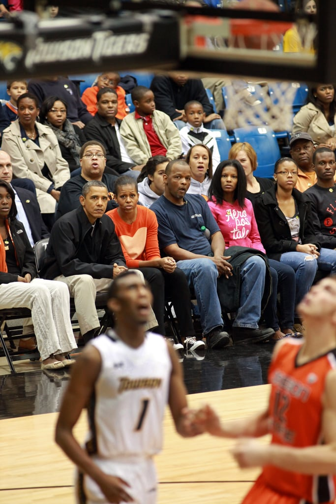 Dressed in Converse and a sweet J.Crew sweater, Michelle and President Obama watched a basketball game in their down time.