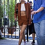 Bella Hadid Sported a Brown Jacket With Matching Shorts and a White Crop Top After the Tod's Show