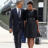 Barack puts his arm around the first lady as they make their way to board Air Force One.