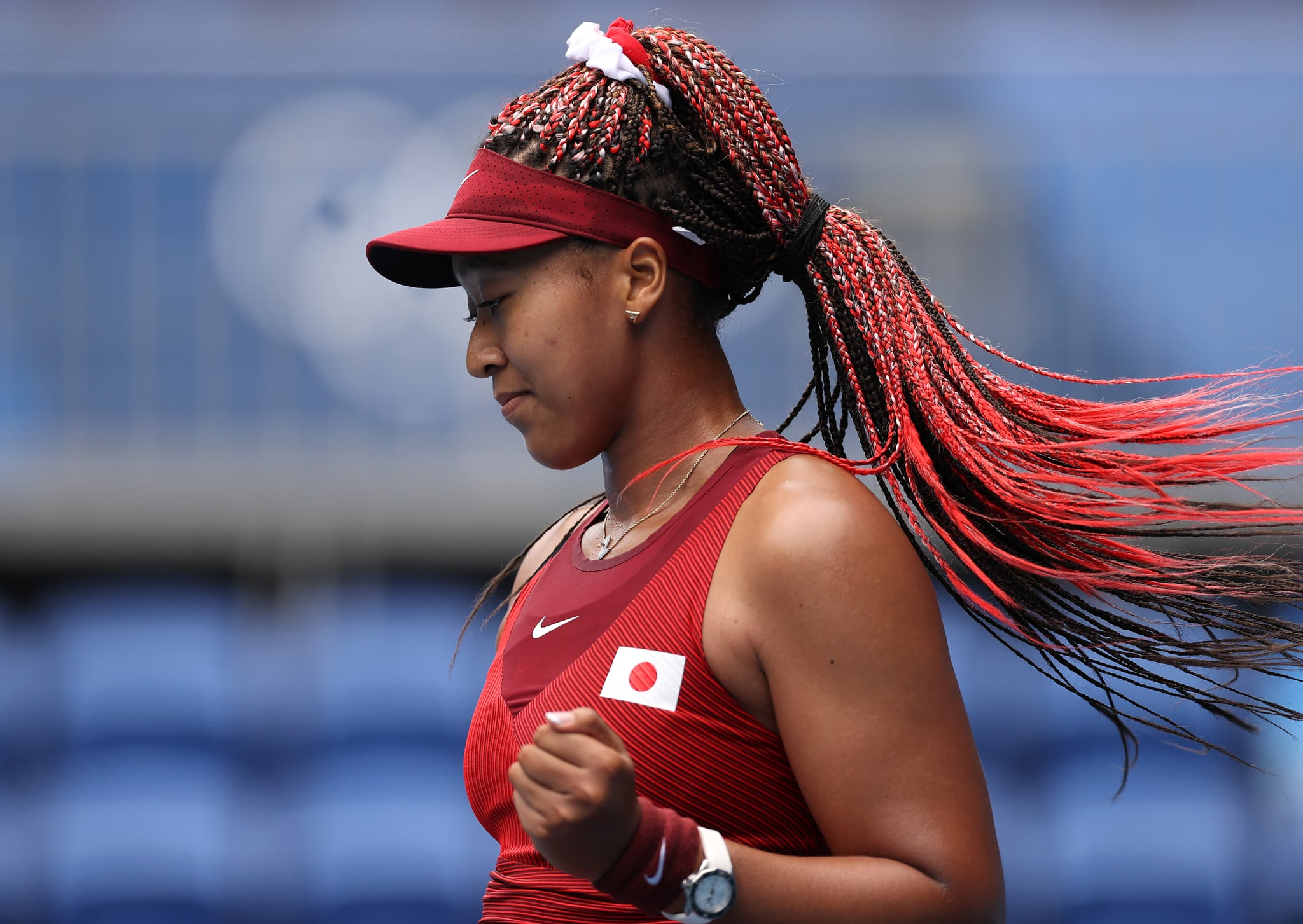 TOKYO, JAPAN - JULY 26: Naomi Osaka of Team Japan celebrates after match point in her Women's Singles Second Round match against Viktorija Golubic of Team Switzerland on day three of the Tokyo 2020 Olympic Games at Ariake Tennis Park on July 26, 2021 in Tokyo, Japan. (Photo by Clive Brunskill/Getty Images)
