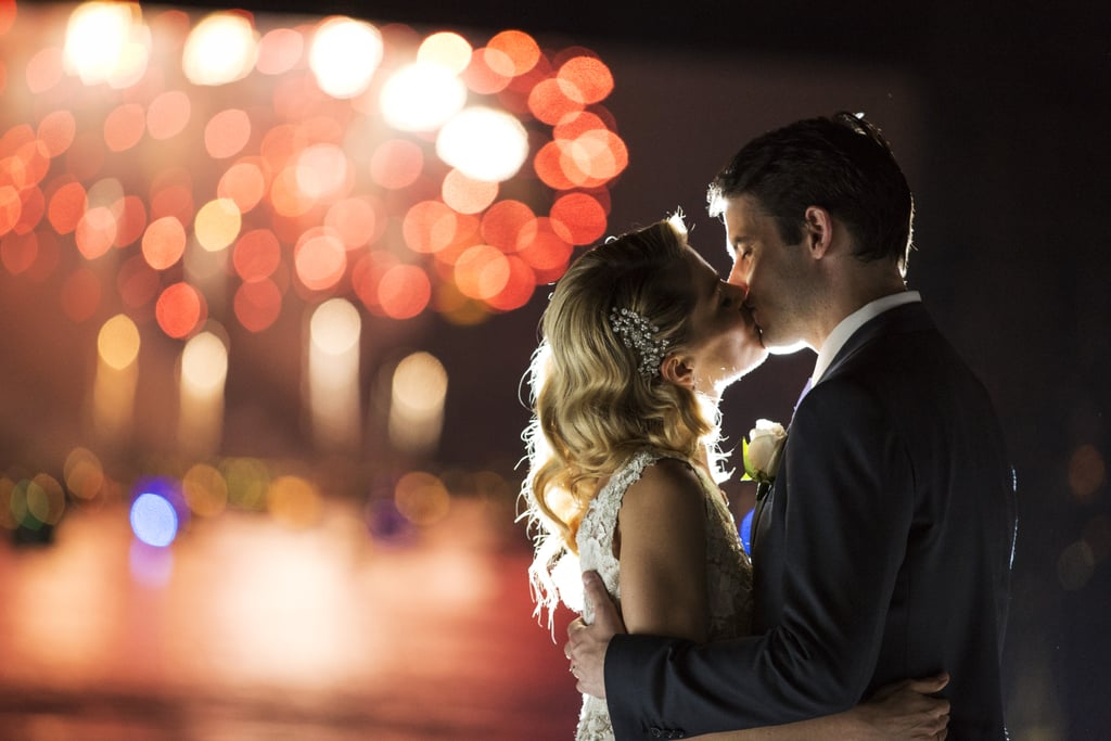The happy pair smooched under the fireworks.