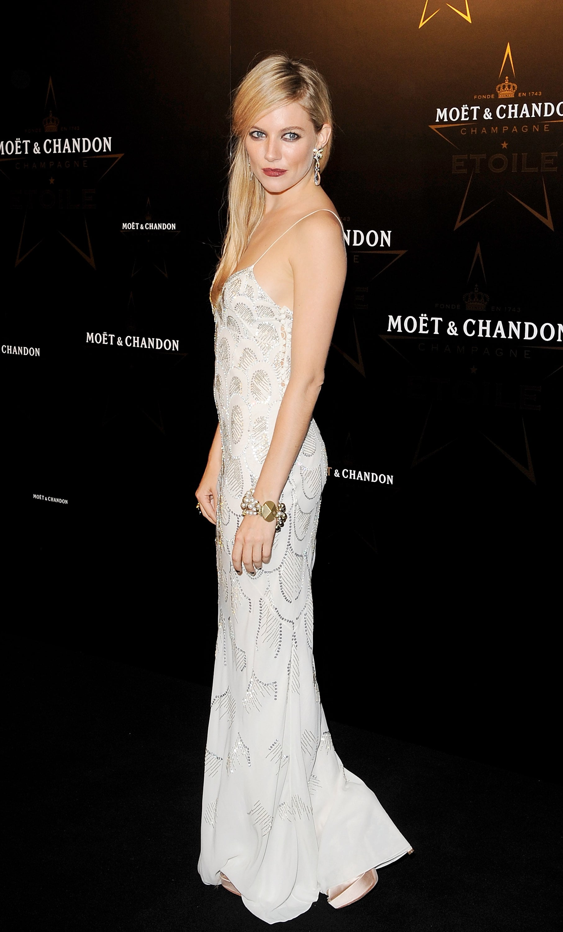 Sienna sparkled in a white Christian Dior gown at an event in 2011.