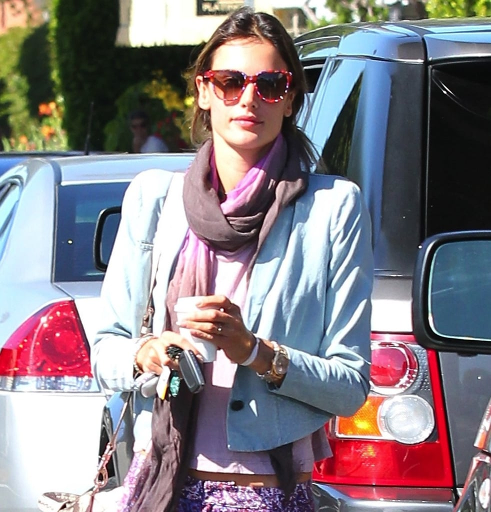 Alessandra Ambrosio's colorful printed sunglasses meshed perfectly with her paisley print Ella Moss pants in LA. Wear these Matthew Williamson printed sunglasses ($389) to ensure Summer fun.