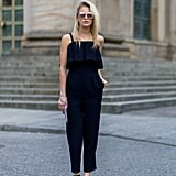 A simple black jumpsuit with strappy sandals