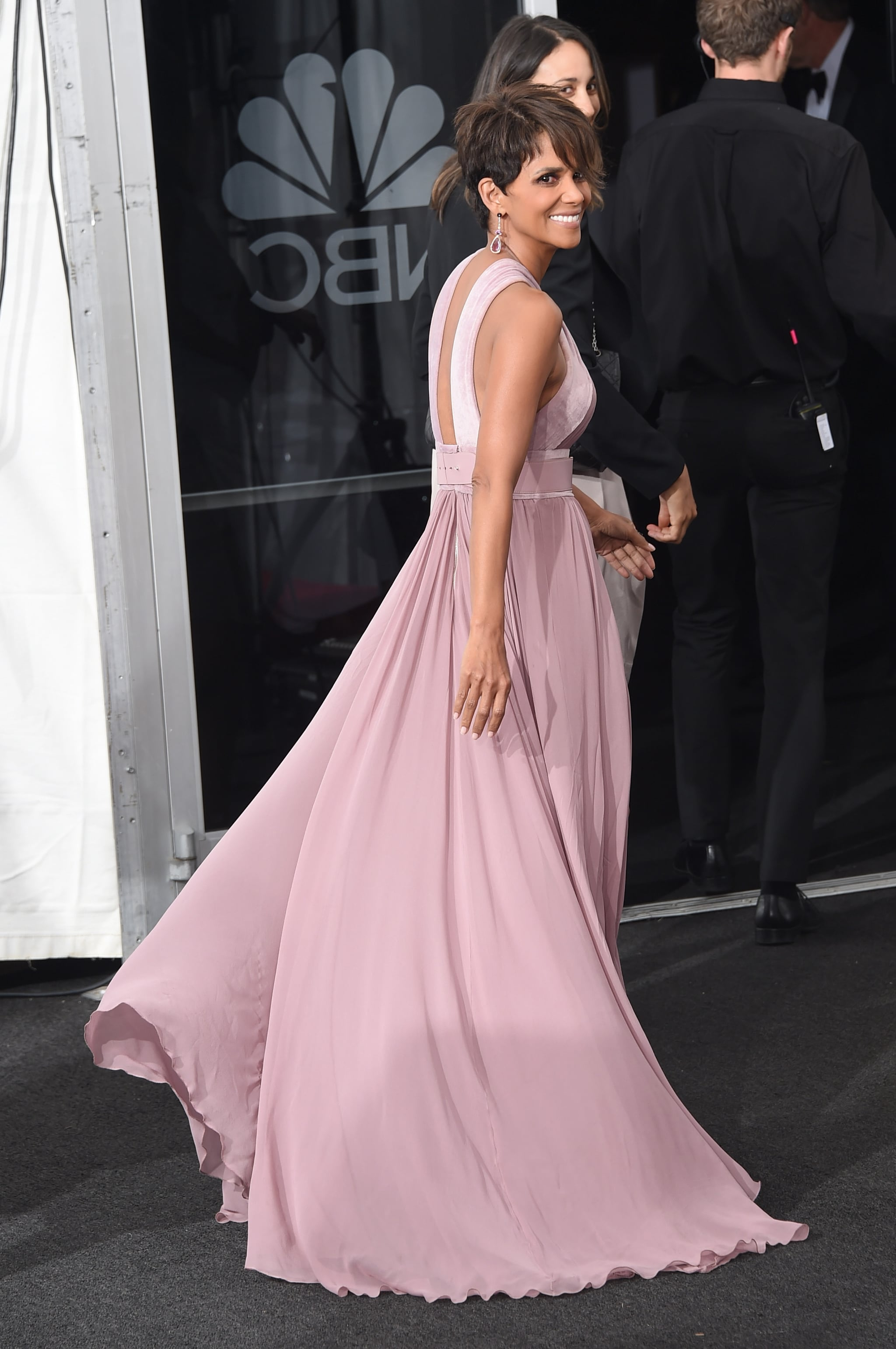Presenter Halle Berry smiled in her flowing gown.
