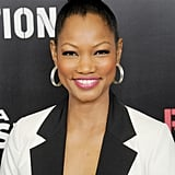 For a similar basket-weave look like Garcelle Beauvais, plait your high ponytail before twisting it into a knot.