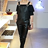 While out in NYC, Olivia gave leather overalls a party-appropriate twist with an off-the-shoulder blouse and pumps, plus an eye-catching statement necklace.