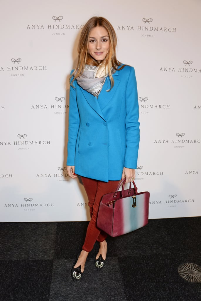 At Anya Hindmarch, Olivia brought her brights, adding a bold blue double-breasted blazer to a pair of rust-hued skinnies.