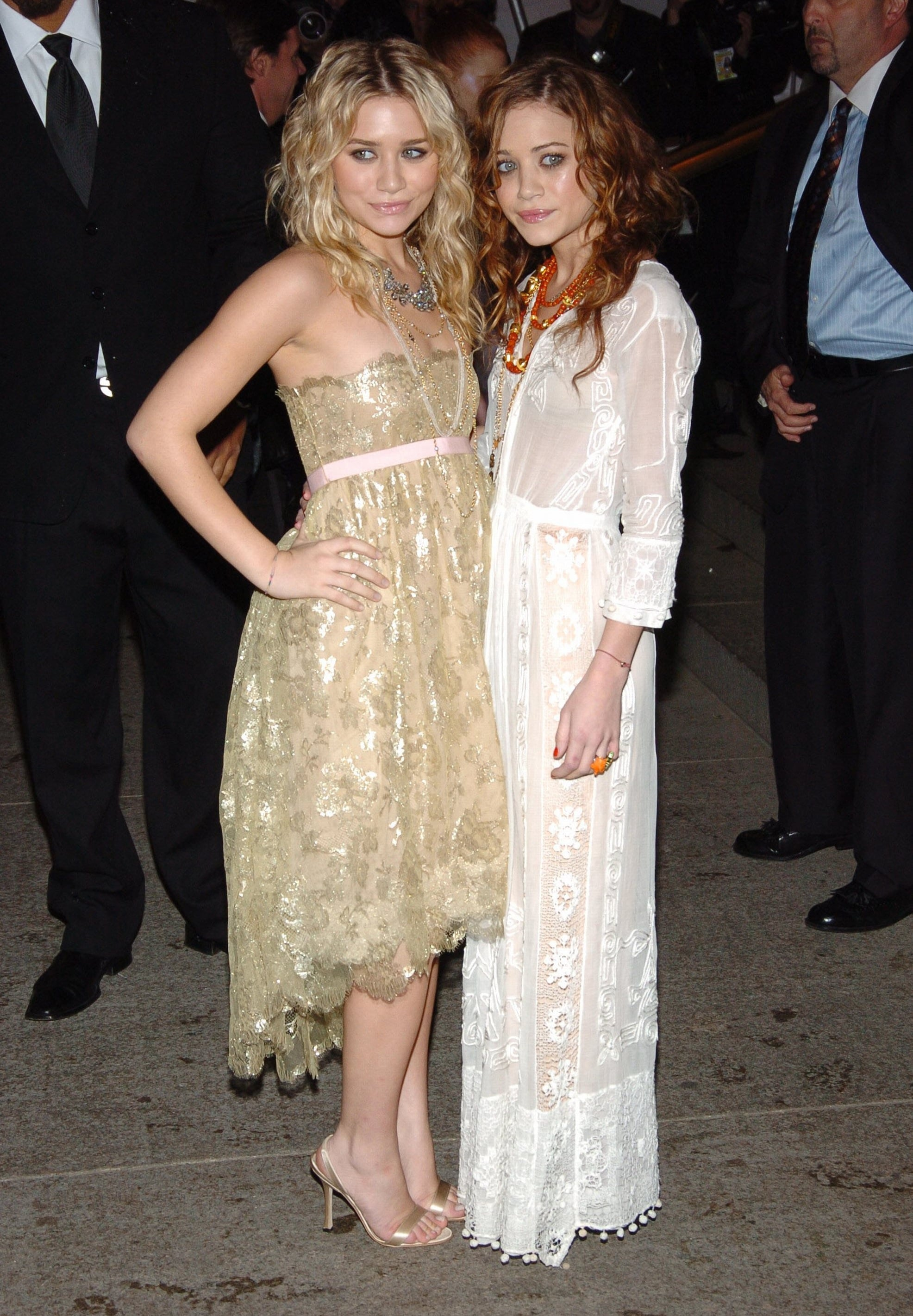 Twinning combo: Mary-Kate and Ashley chose lovely lace numbers for the Chanel Costume Institute Gala opening in May 2005.  Ashley posed in a shimmering strapless dress with foiled lace appliqués, satin sandals, and strands of statement necklaces.  Mary-Kate wowed in a floor-length lace gown, fiery curls, and layers of eclectic necklaces.