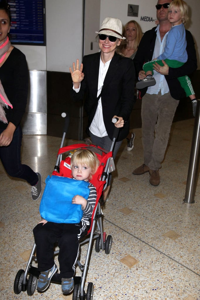 Naomi Watts waved as she landed in Sydney with Samuel Schreiber.
