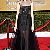 Winner Anne Hathaway dazzled in a black Giambattista Valli Haute Couture gown with an embroidered corset and tulle skirt.