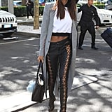Jourdan Was Spotted in Milan Wearing a White Crop Top, Lace-Up Pants, and a Gray Coat