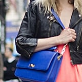 We love how this styler reworked a polished satchel against a tough leather jacket. Source: Adam Katz Sinding