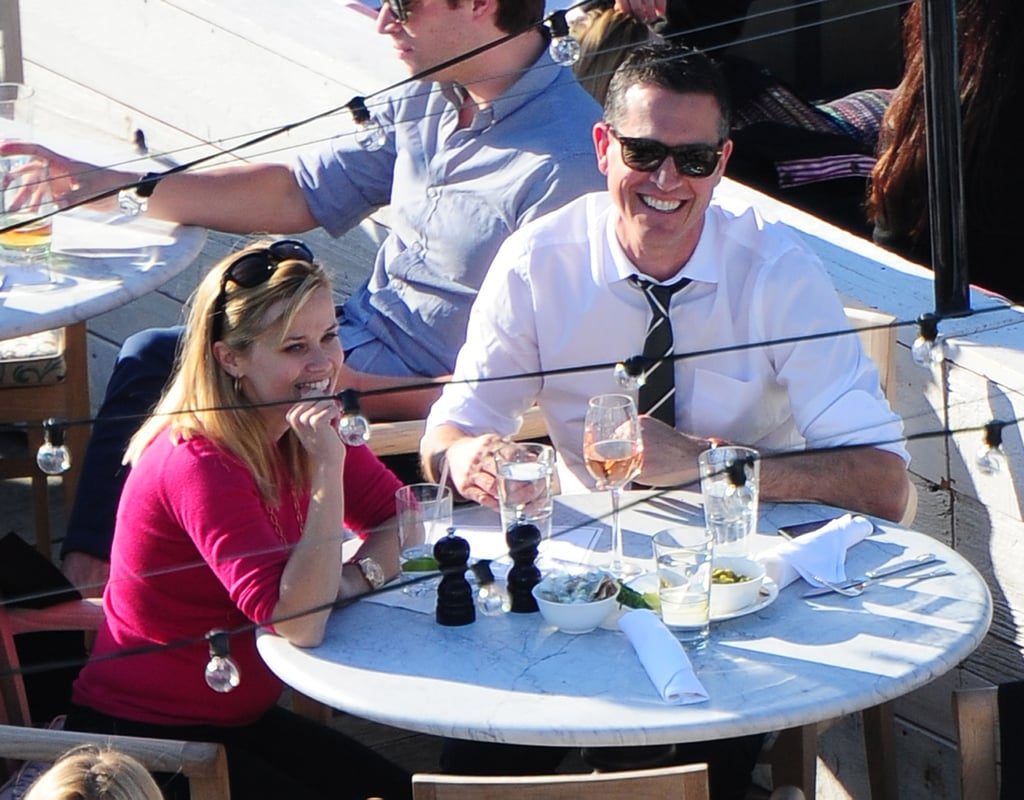 Reese Witherspoon and Jim Toth shared a laugh while dining alfresco at the SoHo House in NYC yesterday. Jim enjoyed a glass of wine while Reese skipped the alcohol and drank water during the meal. The couple spent the day together, running errands and stopping by a C. Wonder store to get in a bit of shopping. Reese and Jim took their trip to the Big Apple after the actress wrapped up filming for The Good Lie in Atlanta. Reese debuted her new blond hairdo when she returned to the couple's home base in LA over the weekend to spend time with her family. She may be getting in a break before she returns to her busy work schedule. Reese recently signed on for Three Little Words, a new film directed by James Mangold. She is also preparing to film Wish List and Men Are From Mars, Women Are From Venus later this year. Don't forget to vote for busy Reese in our POPSUGAR 100 bracket for a chance to win a Victoria Beckham handbag!