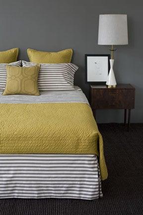 His bedding is the DwellStudio Draper Stripe Set ($308).