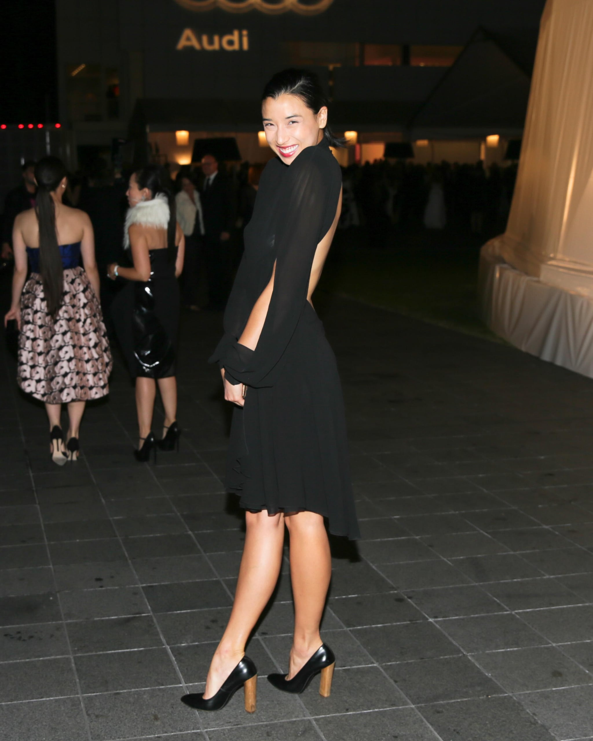 Lily Kwong worked her dress's sexy back in Dallas for the Two x Two event.