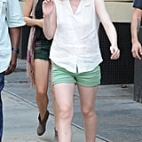 Dakota Fanning paired her outfit with blue wedged sandals.
