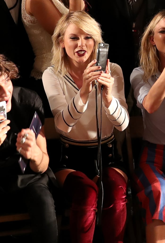 e55de6fa Taylor Swift Sat Front Row at Tommy Hilfiger's NYFW Show, Taking Out Her  Case and