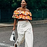 Pair White Pants With a Ruffled Off-the-Shoulder Top