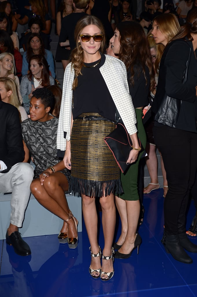 Olivia Palermo matched a fringe skirt with a checkered bomber jacket and an oversize clutch at the Vera Wang show.