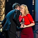 Amy Poehler was congratulated by Matthew Perry and accepted an award at the Comedy Awards in NYC.