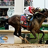 Jockey Joel Rosario and Orb cross the finish line of the Kentucky Derby.