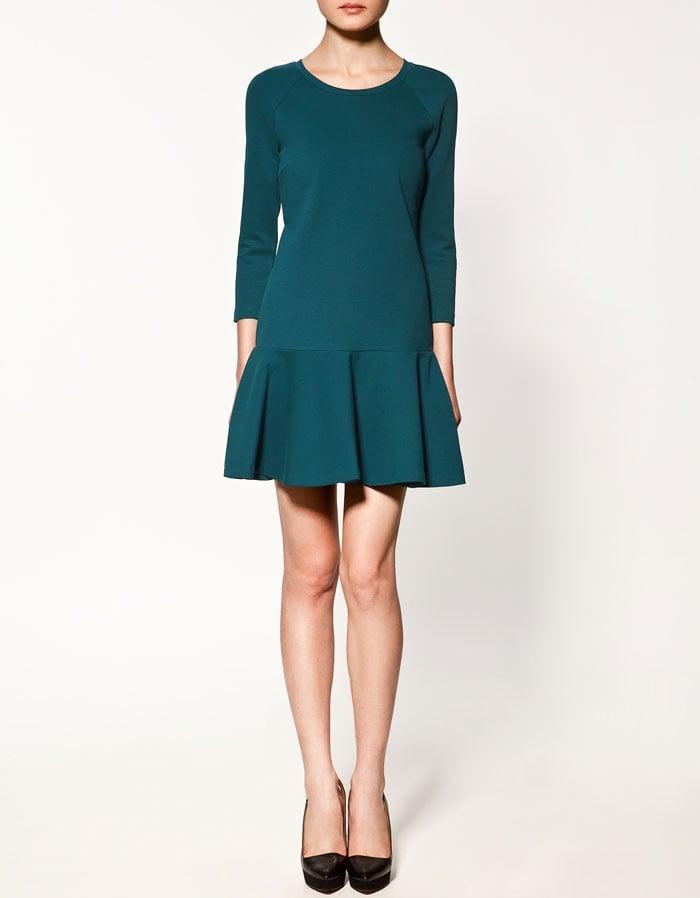 A drop waist detail in dark teal.  Zara Flared Skirt Dress ($80)