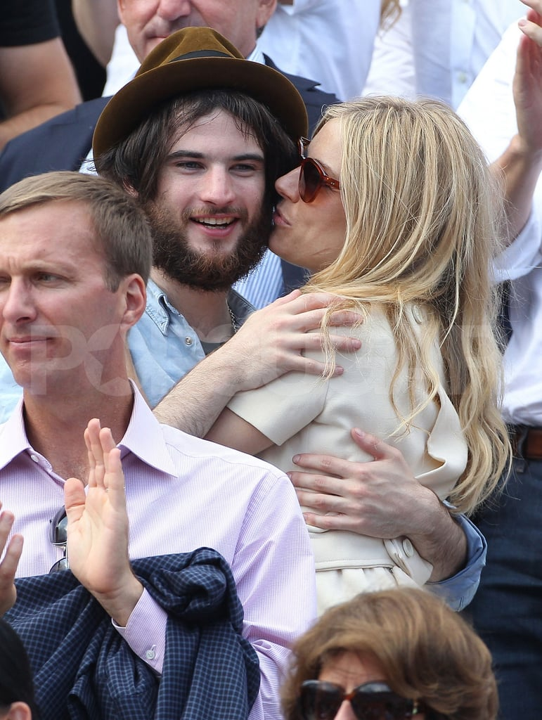 Sienna Miller didn't let Tom Sturridge's serious scruff get in the way of kissing as they watched the French Open in Paris yesterday. The tennis tournament has brought out famous fans like Pippa Middleton, Salma Hayek, Bradley Cooper, and even Anna Wintour joined Tom and Sienna for the sport-filled afternoon. Anna apparently was the one who invited Sienna and Tom to join her in Roger Federer's box along with the athlete's family. Sienna and Tom have managed to enjoy a few getaways in continental Europe despite her busy performance schedule with Flare Path in London's West End—Sienna Miller and Tom Sturridge showed PDA during a recent trip to Vienna. She's due to stay with the production until June 4, which will free Sienna for another busy Summer of showing off her bikini body at some of her favorite beachy spots.