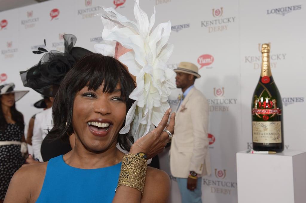 Angela Bassett got a kick out of her hat during the 2014 festivities.