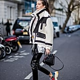 With Leather Trousers and an Oversize Coat