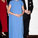 Meghan Markle Wearing a Safiyaa Cape Dress