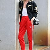 Style a Vibrant Red Pair With an Embroidered Bomber Jacket