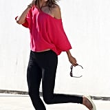 Alessandra Ambrosio sported black leggings and flats.